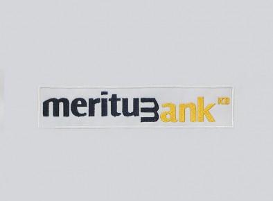 Haft komputerowy przedstawiający logo Meritum Bank